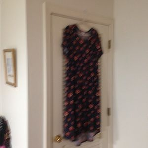 Navy Lularoe Carly with flowers.